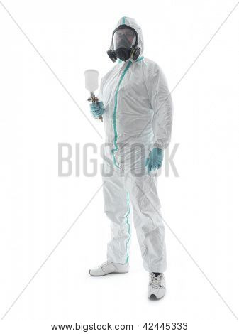 Spray painter wearing white coverall, respirator and spray gun shot over white background