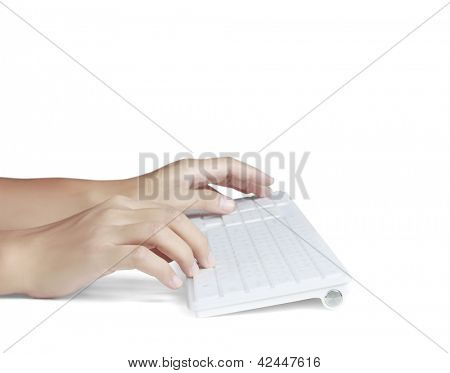 Hands typing on the remote wireless computer keyboard