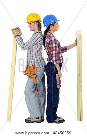 duo of female carpenters standing back to back in profile
