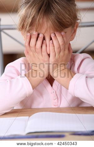 Frustrated girl unable to complete her homework
