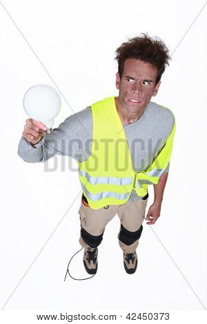 Electrocuted man holding a light bulb