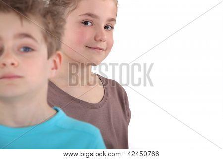 A happy girl standing behind her peer