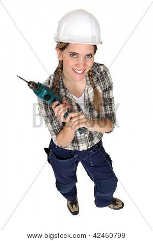 Female builder with a drill