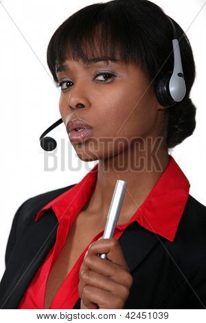 Receptionist shaking her pen