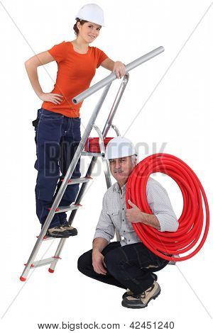 two plumbers working together