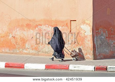 Muslim Woman Walking Down The Street