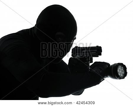 thief criminal terrorist in silhouette studio isolated on white background