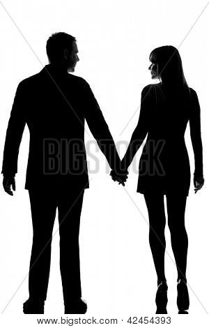 rear view one lovers caucasian couple man and woman walking hand in hand in studio silhouette isolated on white background