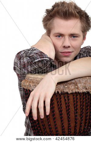 Man sat with bongo drum