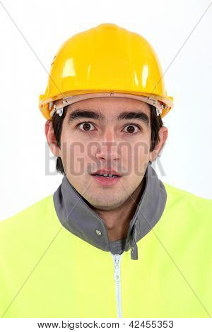 Young builder with look of shock on his face