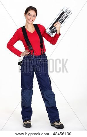 A woman with a tile cutter.