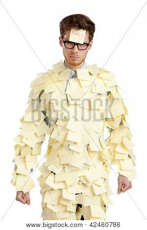 Young male with a sticky note on his face, covered with yellow stickers, isolated on white on white