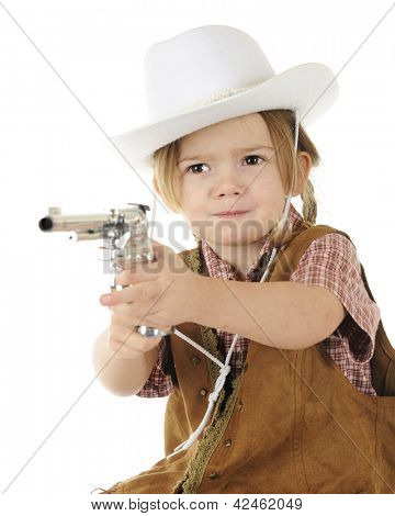 """An adorable preschool cowgirl pointing her cap gun with a stern """"stick 'em up!"""" attitude.  White background."""