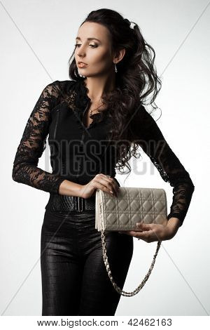 beautiful fashionable woman with handbag