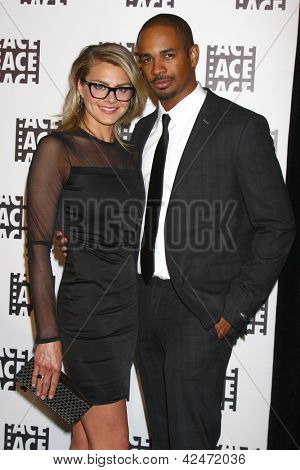 LOS ANGELES - FEB 17:  Eliza Coupe, Damon Wayans Jr arrive at the 63rd Annual ACE Eddie Awards at the Beverly Hilton Hotel on February 17, 2013 in Beverly Hills, CA