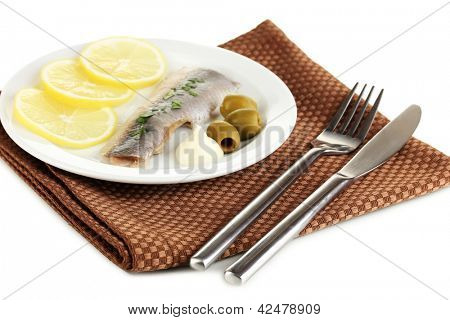 Dish of herring and lemon on plate isolated on white