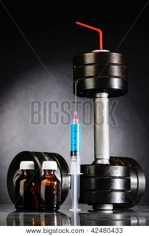 sport stimulants. metal barbells with syringe