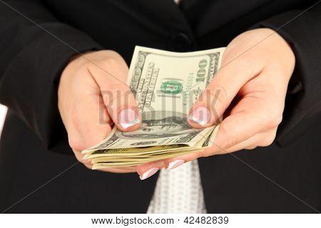 Woman recounts dollars, close up