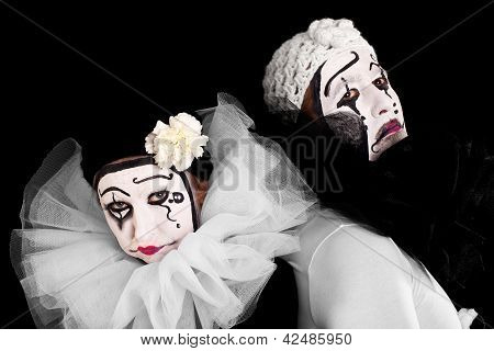 Two Angry Clowns With Black Background