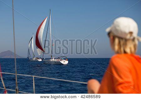"SARONIC GULF, GREECE - SEPTEMBER 25: Competitors boats during of sailing regatta ""Viva Greece 2012"" on September 25, 2012 on Saronic Gulf, Greece."
