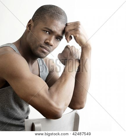 Studio portrait of a good looking young black man against white background with copy space