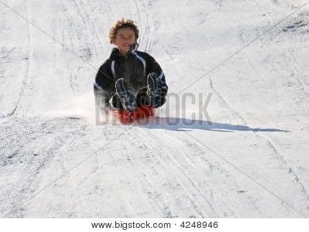 Scared Boy Sledding Fast Down The Hill