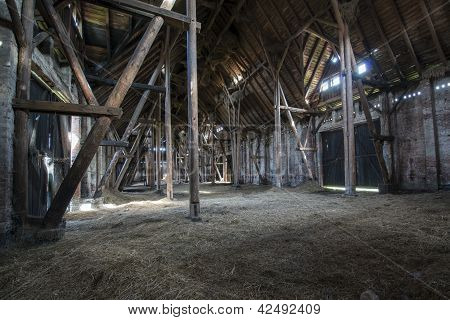 Old Wooden Barn With Light Shining Through Wooden Boards