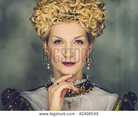 Portrait of beautiful haughty queen in royal dress