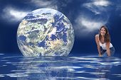 stock photo of geosphere  - The earth floating in an ocean to symbolize the melting of the polar ice caps - JPG