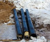 Three Black Pipes On The Snow