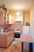 stock photo of dutch oven  - small kitchen of the new moscow apartment interior - JPG