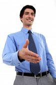 stock photo of friendship belt  - Businessman holding hand out - JPG
