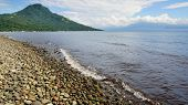 foto of camiguin  - Picturesque sea landscape with island - JPG