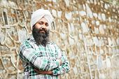 stock photo of turban  - Portrait of authentic Indian sikh man in turban with bushy beard - JPG