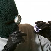 Thief With Magnifier And Jewel