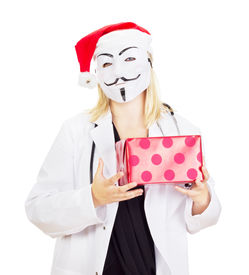 stock photo of guy fawks  - Medical doctor with a guy fawkes mask - JPG