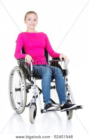 Attractive smiling disabled woman sitting in a wheel chair isolated on white