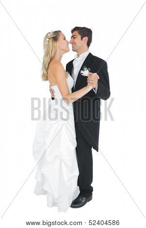 Happy married couple dancing viennese waltz on white background