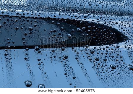 Water drops on polished car paint