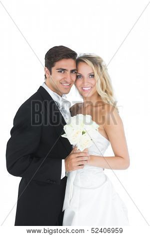 Sweet married couple posing holding a white bouquet on white background