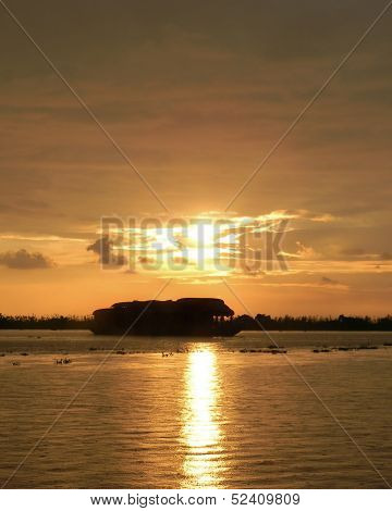 Sunset with tour boat silhouette