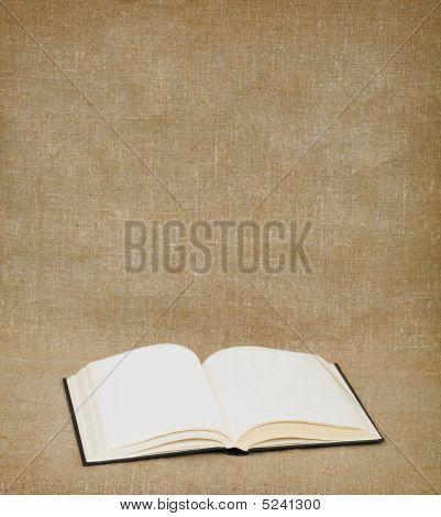 Book On The Fabric Background