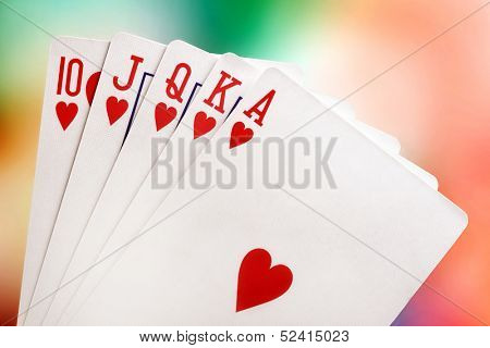 Royal flush with brightly-coloured background