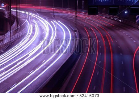 Night time shot of speeding traffic on a freeway