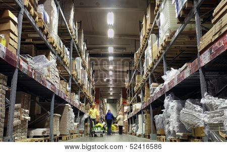 Photo of a corridor of shelves in a warehouse