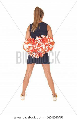 Young Cheerleader Standing With Back To Camera Has Pom Poms