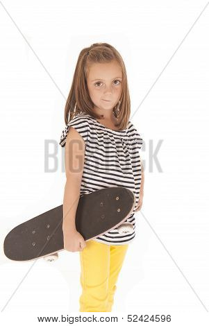 Young Girl Holding A Skate Board With A Smirk On Her Face