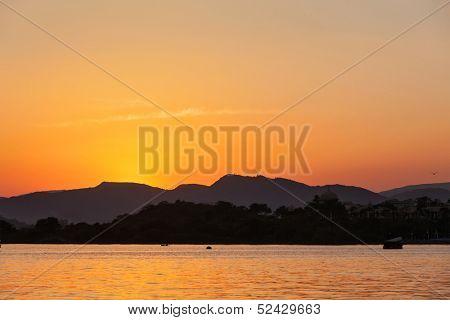 Romantic Lake Pichola on sunset. Udaipur, Rajasthan, India