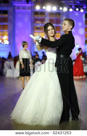 MOSCOW - FEB 22: Couple of young people dancing on Kremlin Cadet Ball, on February 22, 2013 in Moscow, Russia.