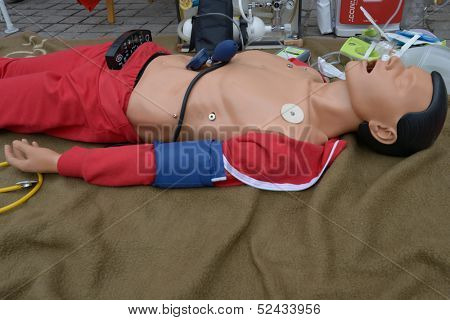 DORTMUND, GERMANY - SEPTEMBER 7: Dummy lying on a blanket with medical equipment attached in Dortmund, Germany on September 7, 2013. Exposition devoted to the 150 anniversary of the German Red Cross